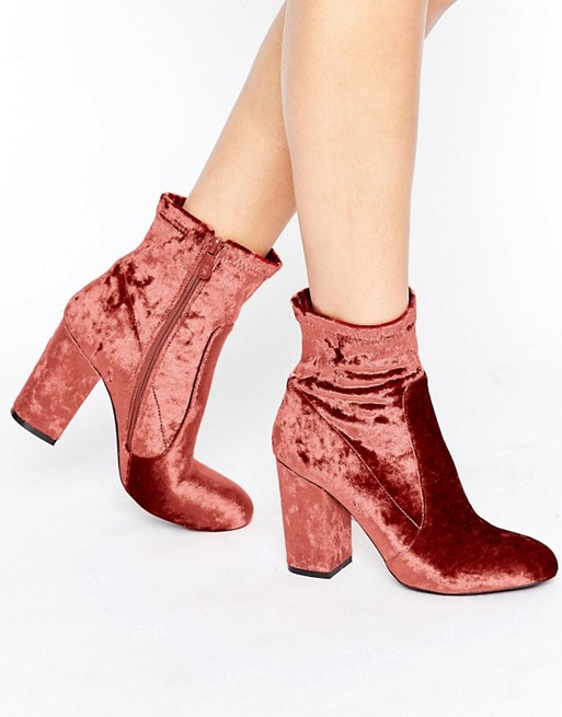 Public Desire - $43 A great velvet bootie to soften up main fall colors like blacks and grays. Feminine and classy, these booties have enough color and shine for an entire outfit. Would be cute with nude lips, no?