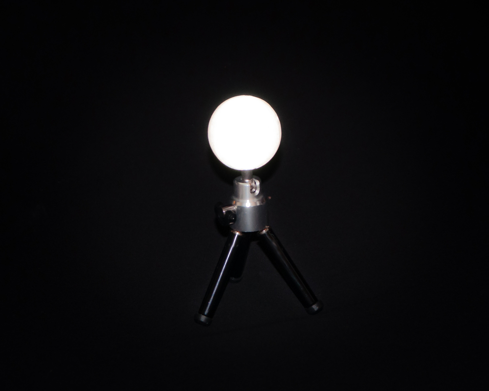 Retroreflective, spherical target for photogrammetry.