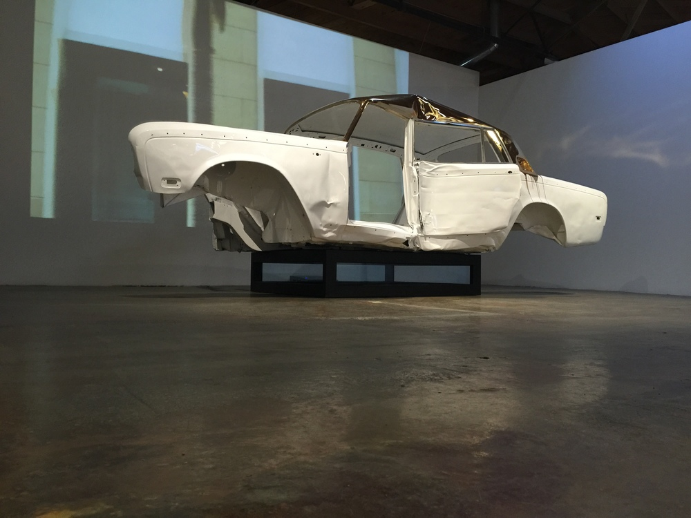 Rodeo Drive , 2015, found car body, powder coat, chrome, automotive finish, steel, polished aluminum, plexiglass, 11:16 single channel video  57 x 183 x 63 inches   (145 x 465 x 160 cm)  Photo Courtesy of MAMA   James Georgopoulos 2015