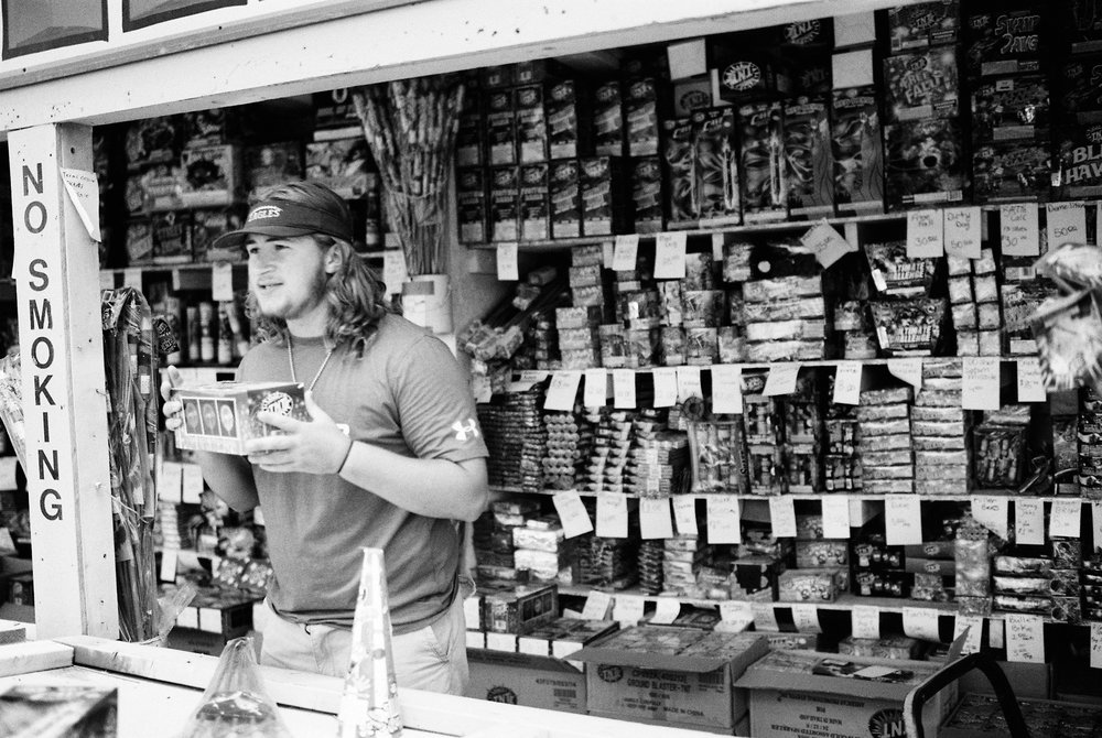 man-sells-fireworks-outdoor-stand