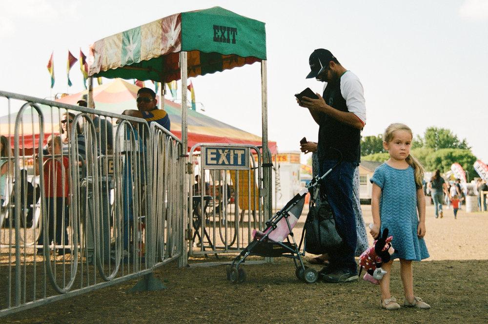 blue-dress-girl-carousel-fair