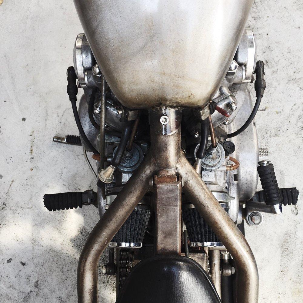 Detail of vintage motorcycle - The Skulls
