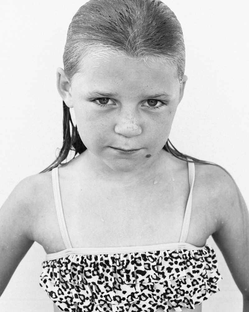 Black and white portrait of a girl in a swimsuit by Ryan Pavlovich Photography