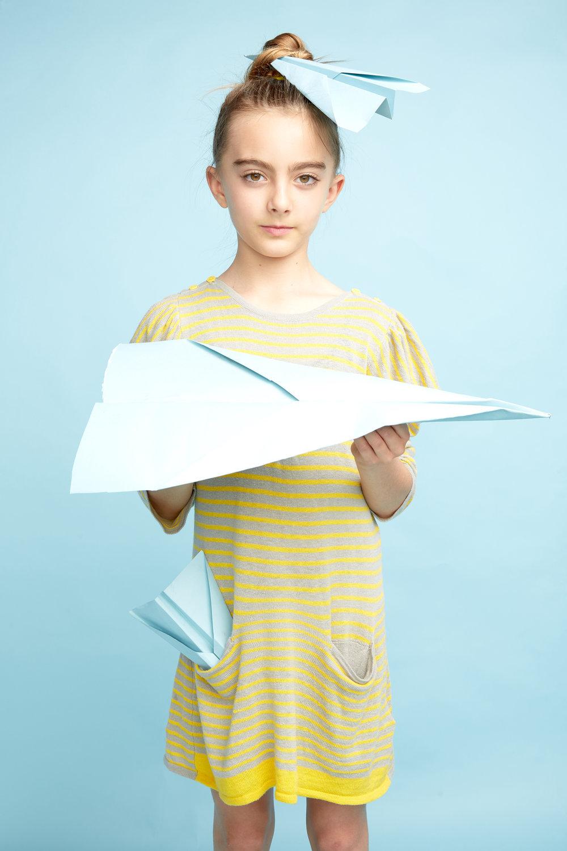 Girl with paper plane in studio - Ryan Pavlovich