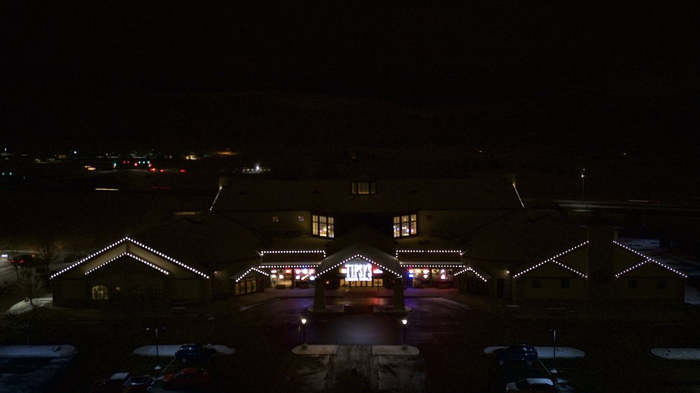 Tipsy's Beverage World - Any size job, we can handle them all. This 87,000 sq foot building in Littleton Colorado is outlined with magnetic C9 pure white buibs. The moment these lights were installed instantly this building was noticeable from every direction.