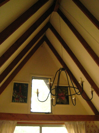My grandfather made that chandelier, and it's on a nifty pulley.