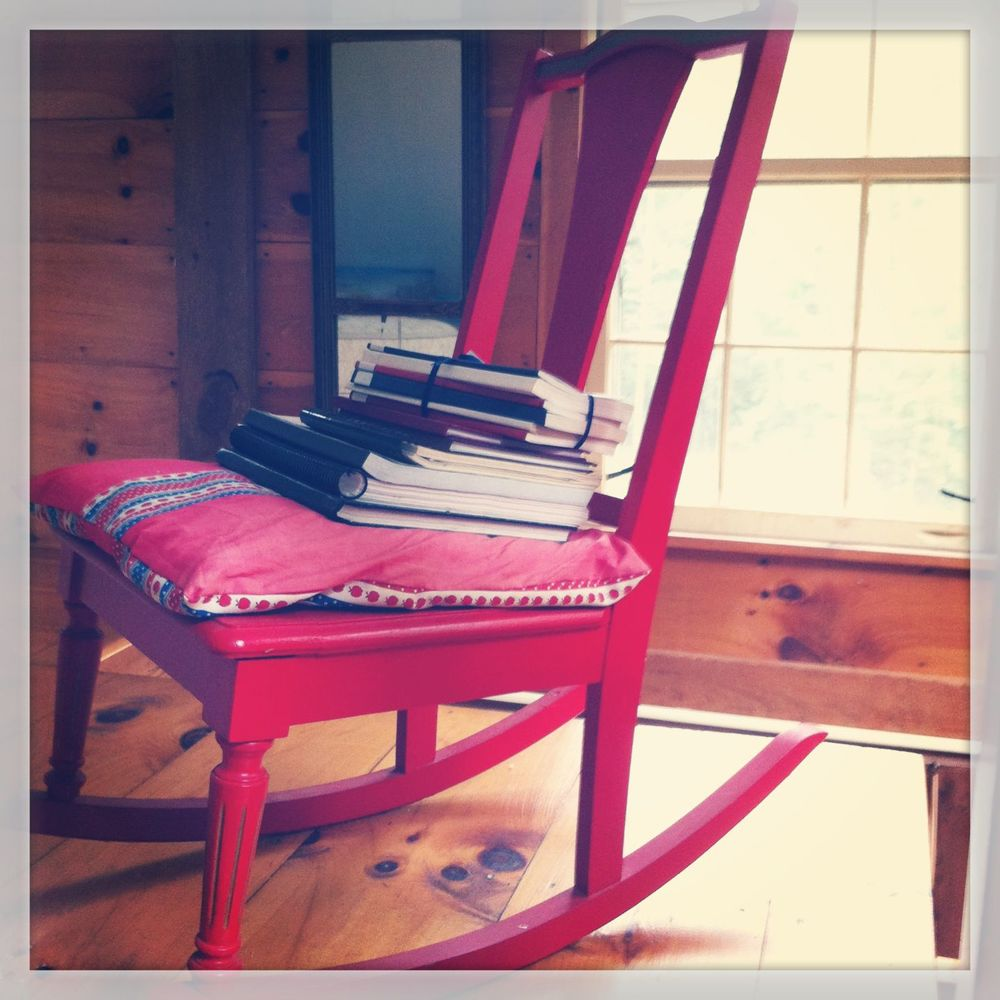 My grandmother's chair piled with books my family has written.