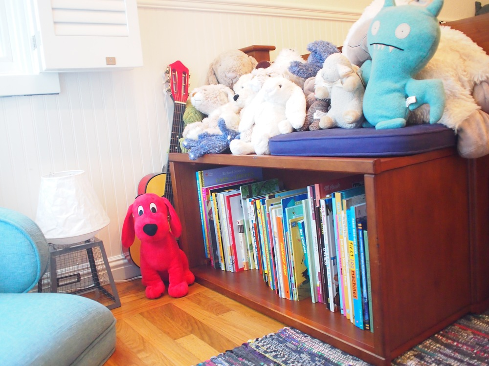 I turned his existing toy box on it's side to make a bench/bookcase.
