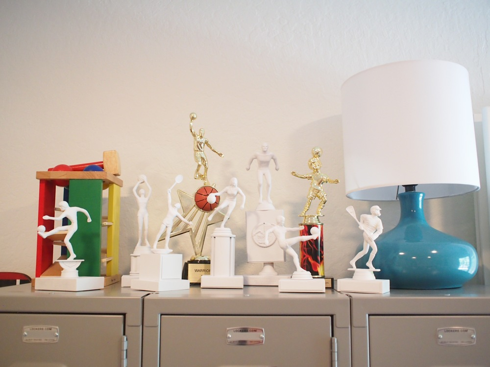 To show off his trophies I bought some old ones and spray painted them all white.