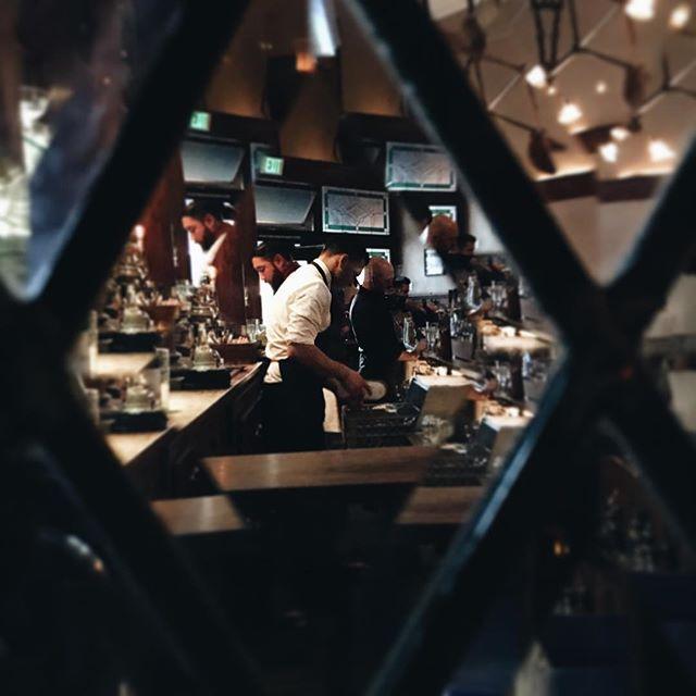 Comstock bartenders through beveled glass. #comstocksaloon #ilovethisbar #ilikeitwhenthingslookpretty #bartenders #orderthecherrybounce #vsco #vscocam