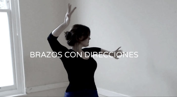 FLAMENCO DANCER DEMONSTRATES BASIC FLAMENCO ARM WITH DIRECTION CHANGE OF THE UPPER BODY.