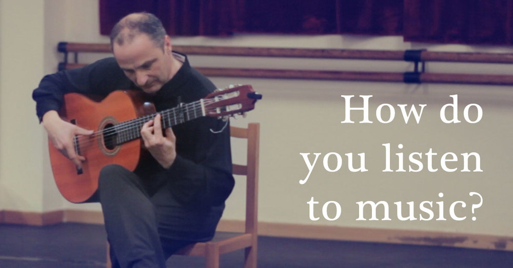 How do you listen to music? - photo of flamenco guitarist | flamencobites.com