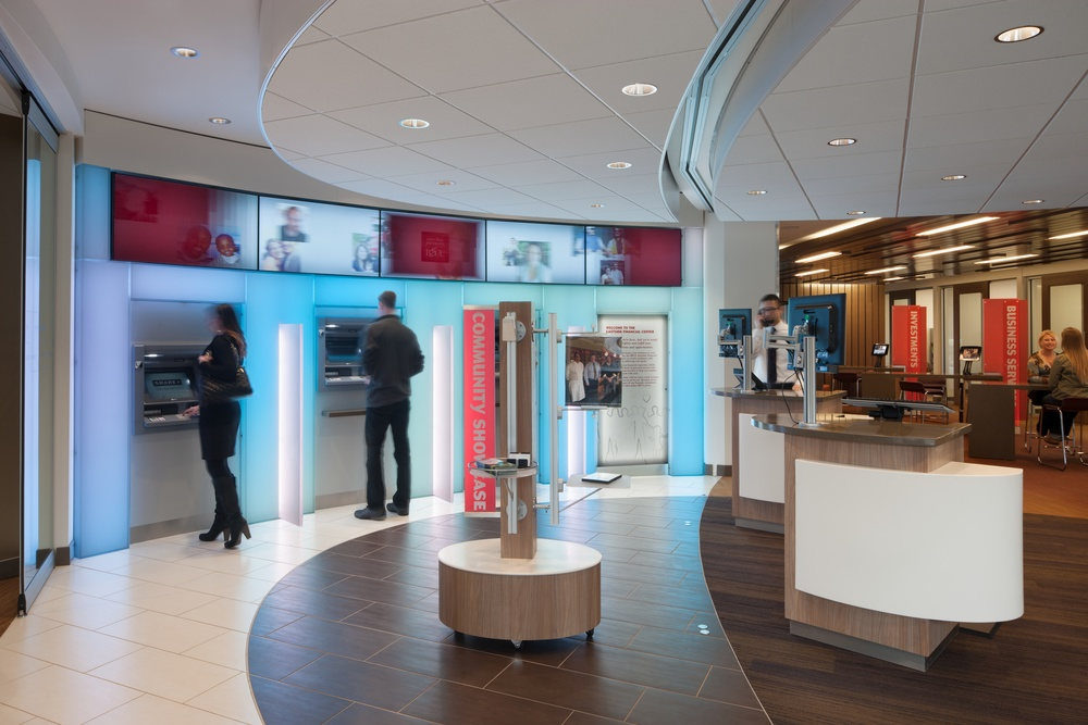 A smart 24/7 foyer with rolling walls surrounds at ATM digital light wall and expert Mobile Concierges at the new BECU Regional Financial Center, Bellevue, WA.