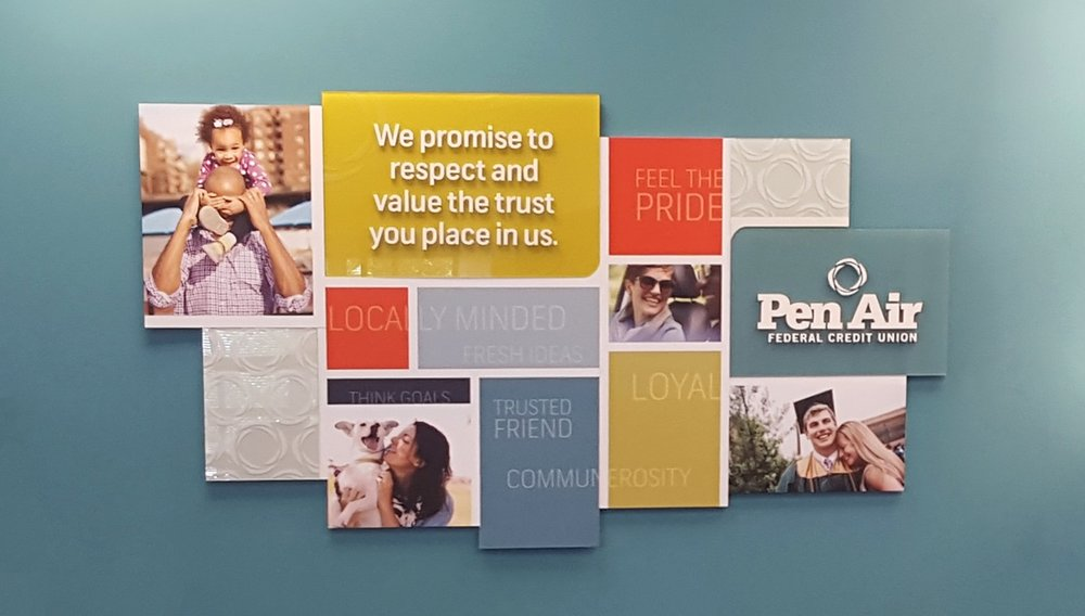 A brand wall prominently features Pen Air's brand promise in all branches.