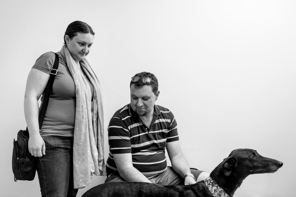 Shona and Michael with Violet, a greyhound they adopted from a rescue group. They had spent 2 years transitioning Violet from a dog that only knew how to chase white furry things to a socialised and happy animal. Many people who adopt seem to show a lot of passion for doing the right thing by their animals.  28 February, 2018. Brudine Veterinary Hospital. Charnwood, ACT.