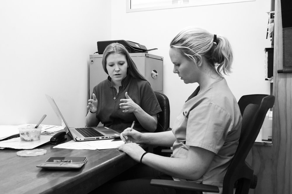 Practice Manager Bri Smith ( left ) and Head Nurse Stephanie Robertson wrangle a roster for twenty-five full-time, part-time and casual staff.  31 January, 2018.