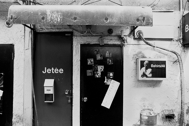 "LA JETEE , a set on Flickr. RIP CHRIS MARKER.   I first saw his seminal film 'La Jetee' one afternoon in 1998. It was my first ""art film."" I could not understand what it was ""about"" at first. But I also couldn't help to be utterly captured by it. The film scared me in the way nothing ever had before. I fell in love with it. I never fully believed in the power of images. At least not in the way Chris Marker showed me. 26 minutes of grainy black and white still images, edited together with stark voice over. And then it hits you with a one two punch for a few seconds at a moment of perfect crescendo, motion. A woman blinks for a few frames of film. Perfectly timed. Wow.   I'm a firm believer that such great films can instill such dread, yet can inspire and influence all at once.    It's because of Chris Marker and La Jetee, that I will always see myself as a filmmaker who makes films in photographs.    ""This is the story of a man marked by an image from his childhood…""   Photos from the Jetee Bar taken in 2005  here . My film professor,  Jean Pierre Gorin  sat at that very bar with Marker the last time they were there. It's become sort of a meeting ground and mecca for filmmakers who come through Tokyo."