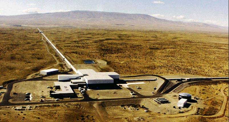 The LIGO facility in Hanford, WA, features perpendicular laser beams housed in vacuum-sealed cylinders almost 2.5 miles long.