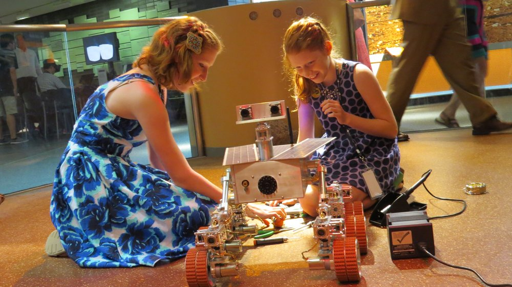 Camille and Genevieve Beatty fine-tune their working model of the Mars rover, Spirit.