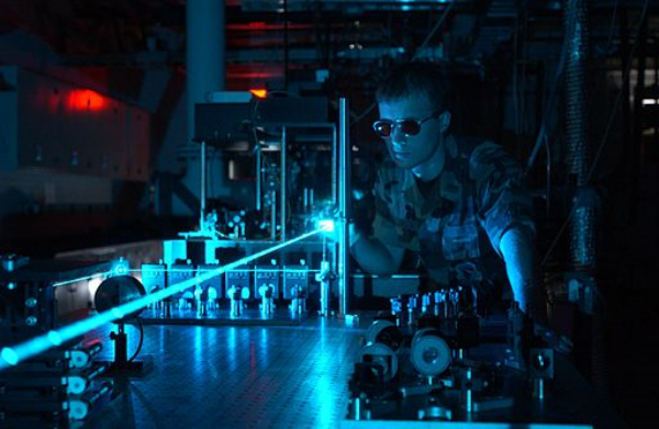 An electrical engineer tests out experimental laser weaponry technology.
