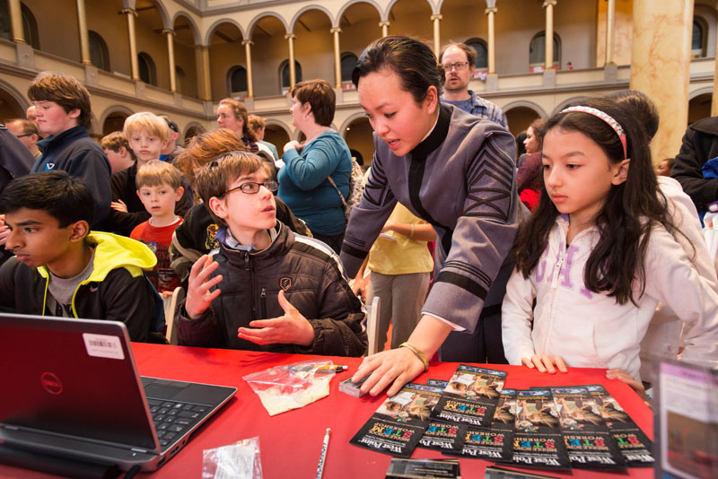 At Family Engineering Day in Washington, DC, a West Point engineering student talks with kids about what engineers do and how it benefits everyone's daily lives.