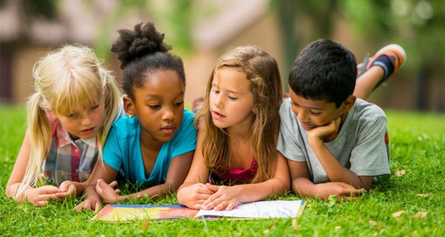 P88 - kids reading outside.jpg