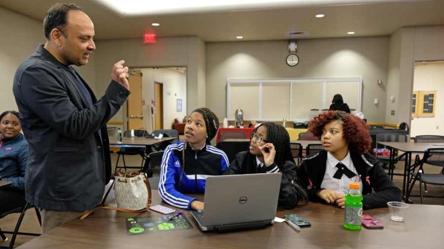 High school students get coaching during a cybersecurity competition at the University of Missouri-St. Louis.