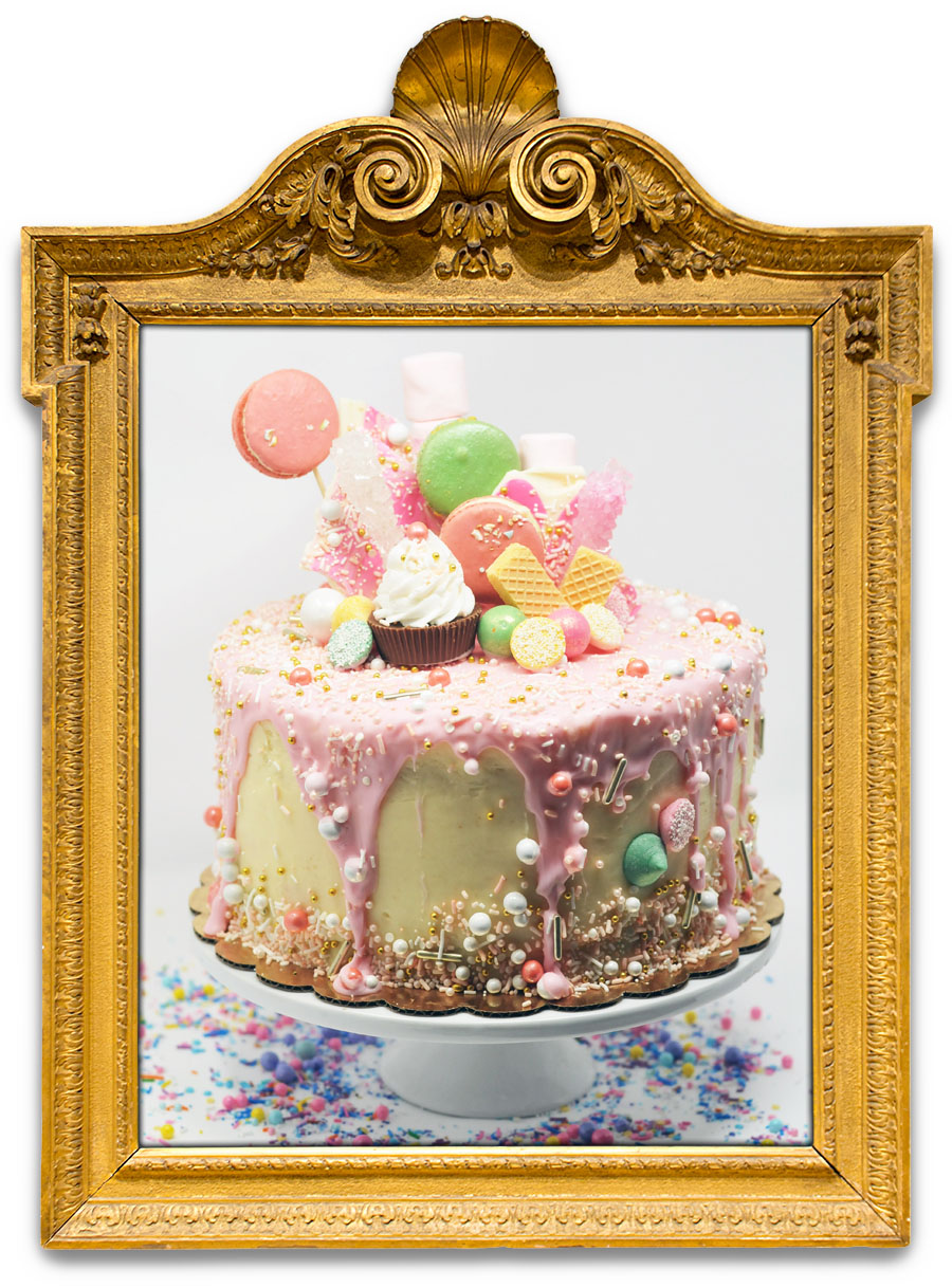 I ♥ PARIS   Let them eat cake! We're sure this cake inspired Marie Antoinette's famous saying (or not)! White cake with cream cheese buttercream, dripped with pink chocolate, topped with handmade macarons, mint sprinkle pareils, and gold sprinkles.