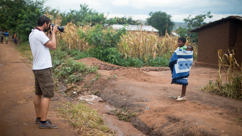 Content Director Robert Ditcham shooting stills on location in Malawi.