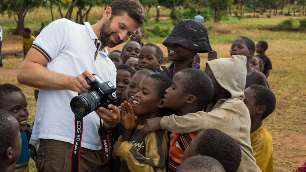 Content Director Robert Ditcham on location in Ncheu, Malawi. The children react after being shown images of themselves.