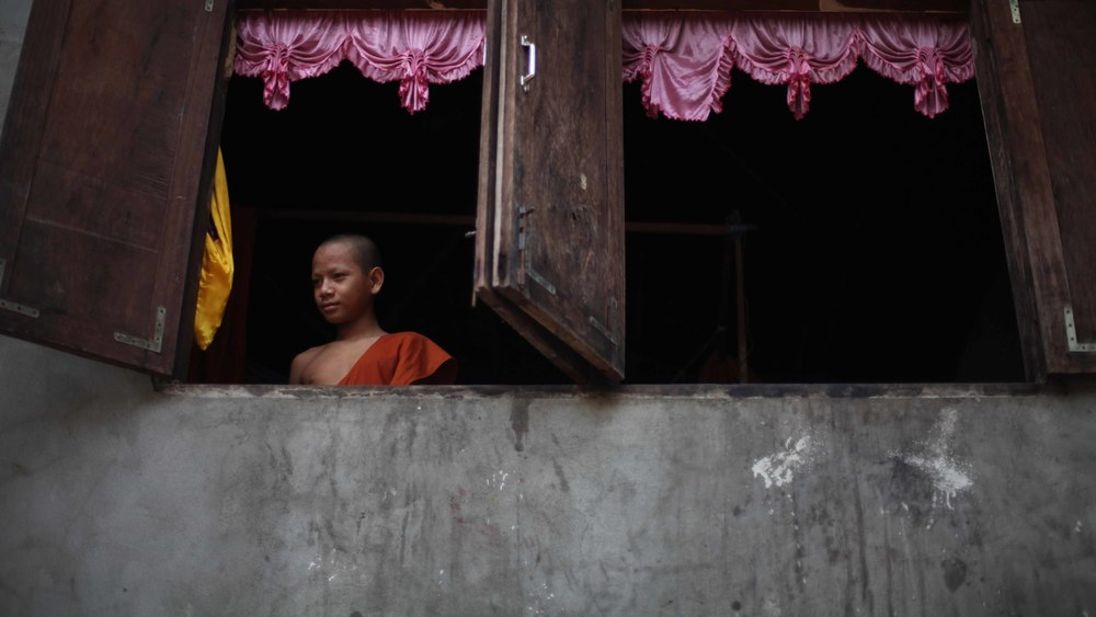 A young Buddhist novice monk at the Ankor Wat temple complex in Siem Reap, Cambodia.  Featured as the main art accompanying a travel feature.