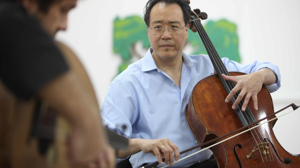 Cellist Yoyo Ma plays alongside Kamal Mussallam during a presentation at a school in Abu Dhabi.  Published as accompanying artwork in The National newspaper.