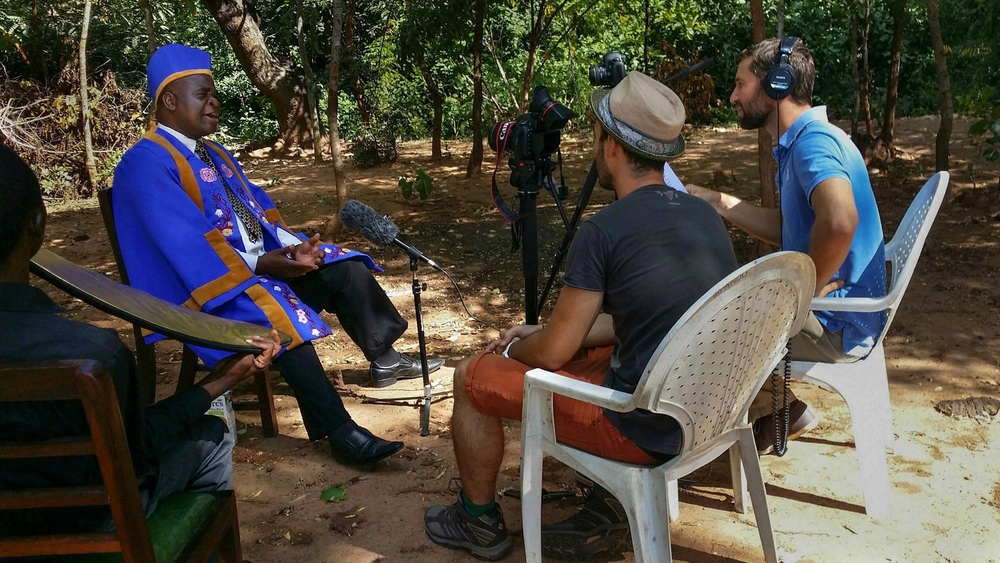 Mandolin Media's Content Director Robert Ditcham and Creative Director Paul O'Driscoll interview tribal elder Chief Kwataine in Ncheu, Malawi. Assistant Alfred Nedi Mwenitete provides lighting support.