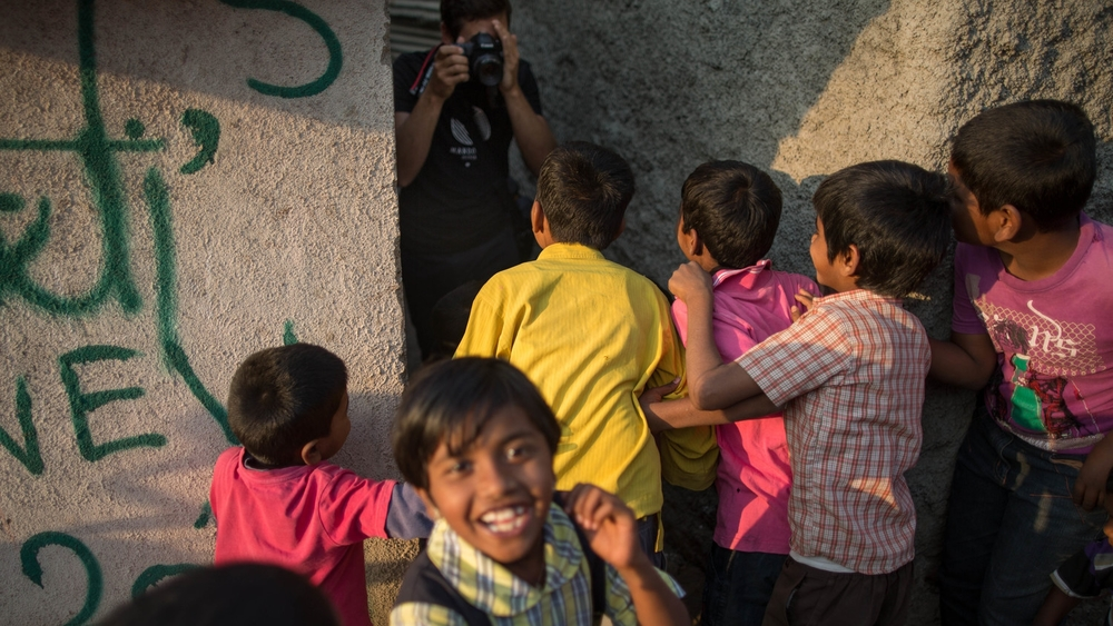 Content Director Robert Ditcham on location in Pune, India. The children react after being shown their images.