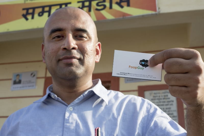 Swapnil Chaturvedi, the  President and CEO of Samagra Waste Management, displays his tongue in cheek business card, which embraces his nickname 'Poop Guy'.