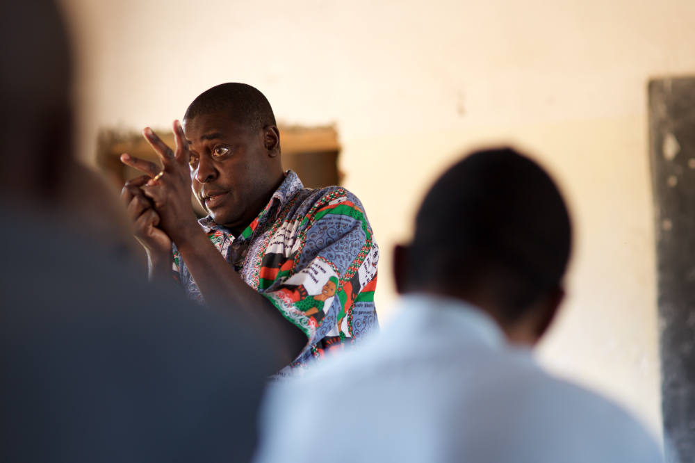 Timothy Bonyonga, of Malawi's Safe Motherhood Initiative, leads a Chief Mobilisation Workshop in Kasungu, Malawi. The organisation introduces tribal chiefs to practices that safeguard women and babies' health during and after childbirth.   Part of a photo essay for the Bill & Melinda Gates Foundation.