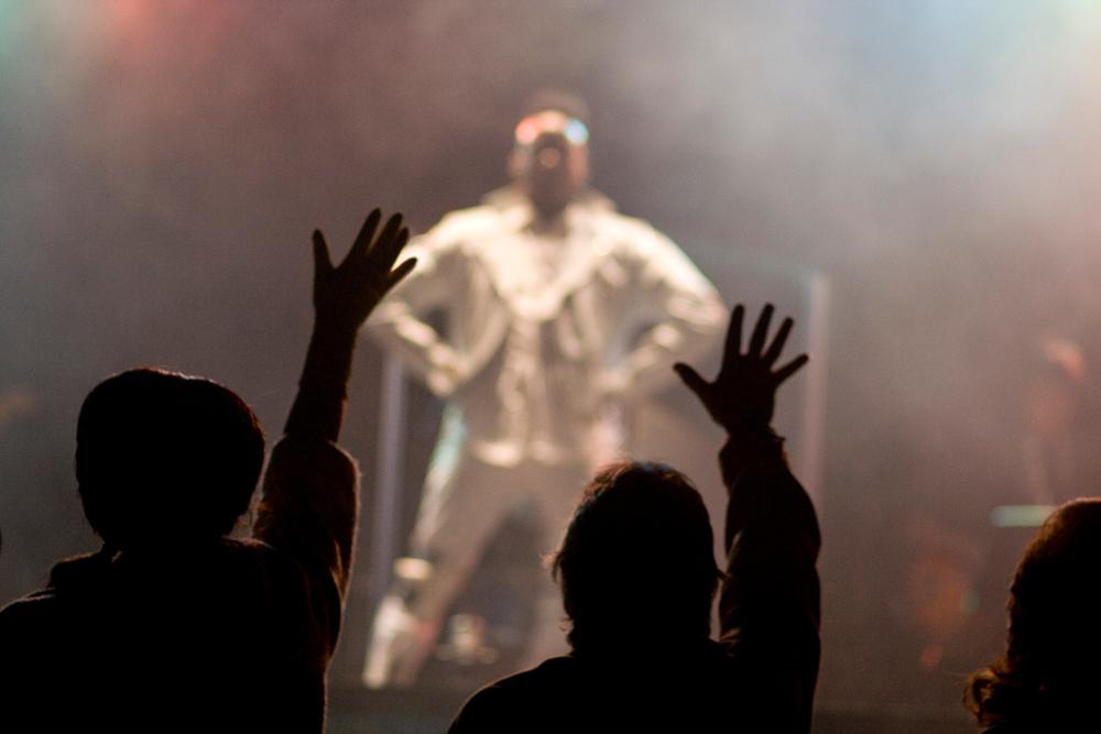 B. Slade performing live