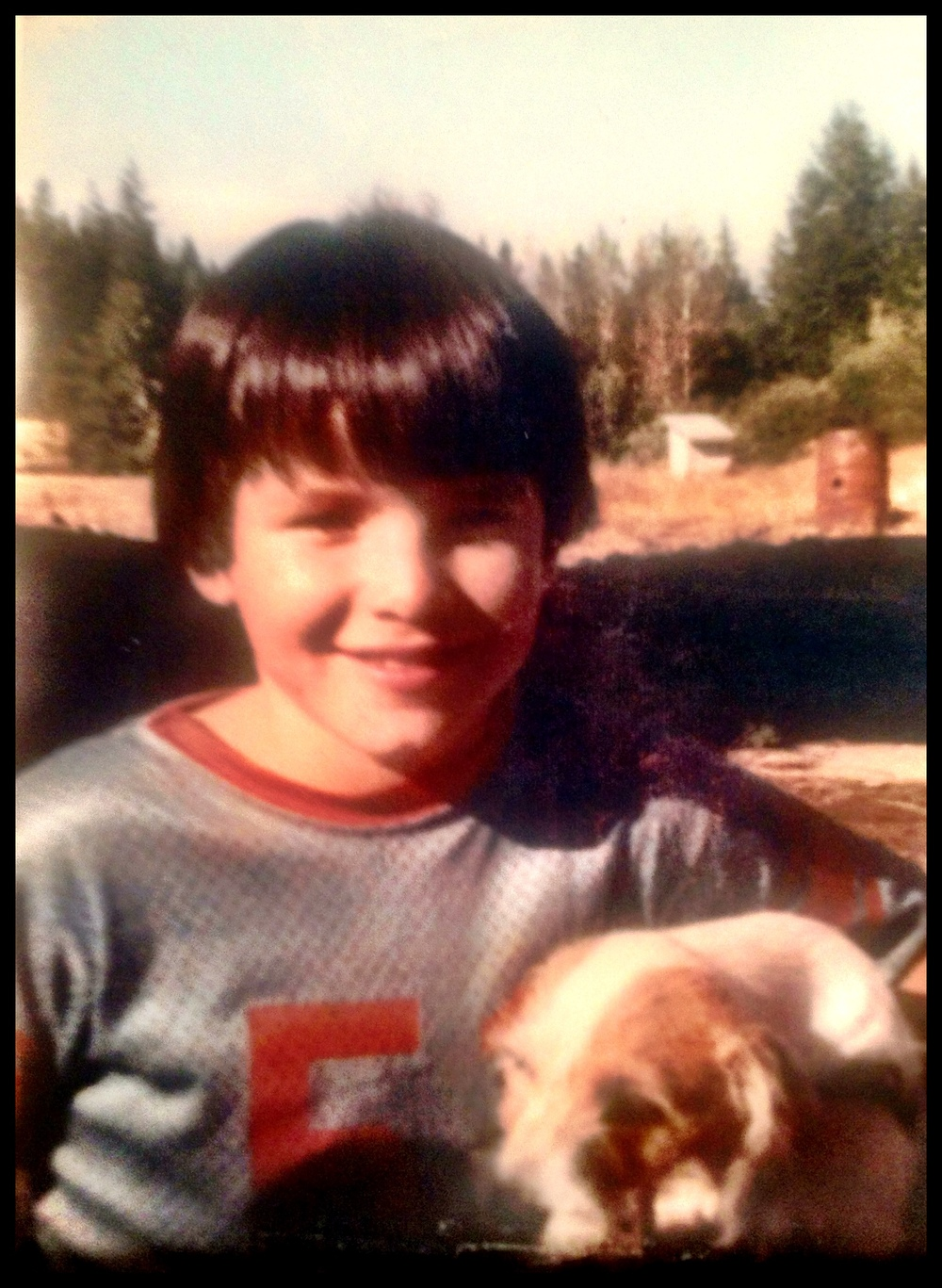 Arnold, my big brother, with our dog Hobo, circa 1974