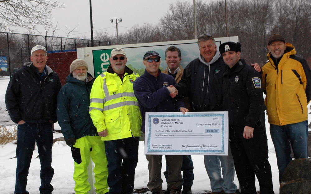 From left to right: Russ Ellis, Jay Wennemer (Town Conservation Agent), Tom Reynolds (DPW Superintendent),  Ross Kessler (Mass. Division of Fisheries),   Craig Alvey,  Bud Duksta, Mike Dimeo (Marshfield  Harbormaster) , & Gary Covitz on a cold snowy Friday afternoon at Peter Igo Park.