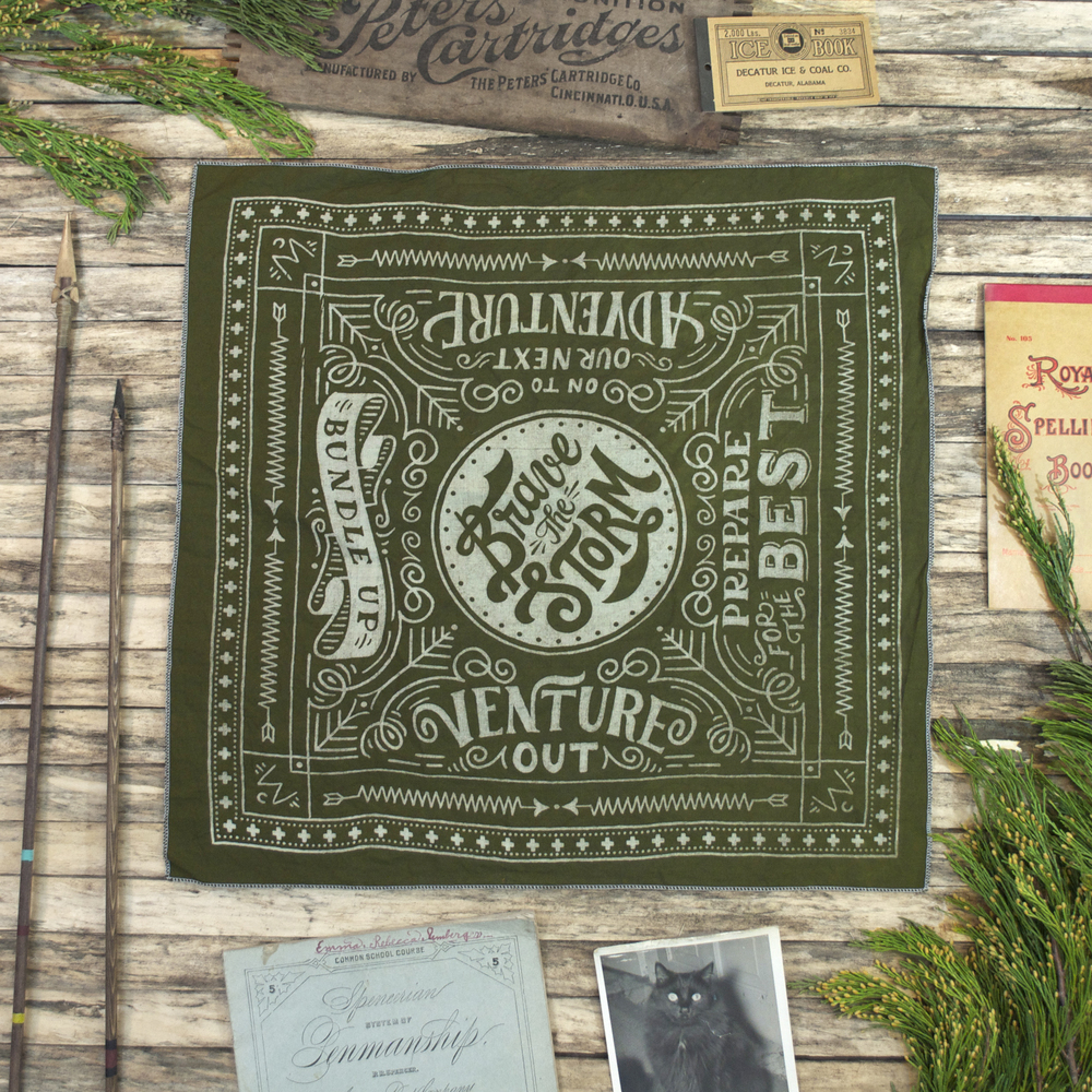 Green Winter Cabin bandana with props.jpg