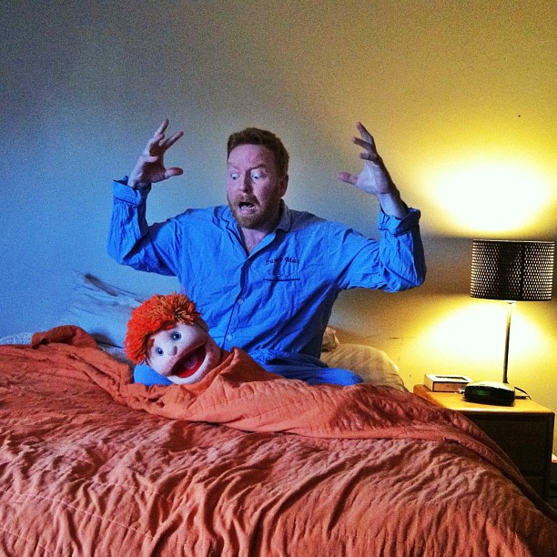 Dave and Puppet Head in bed