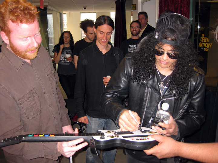 Dave gets his Guitar Hero guitar signed by Slash