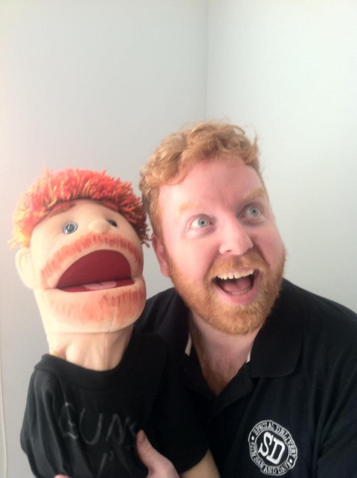 Dave kisses his puppets