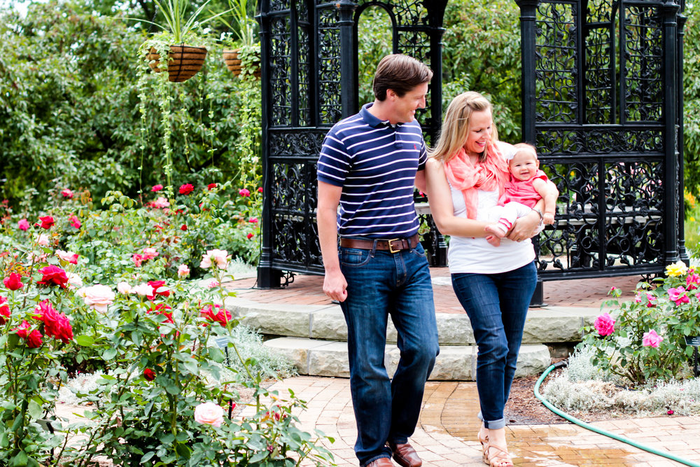 Lauren and her husband walk with their baby during their Family Photography Session in Muncie, Indiana