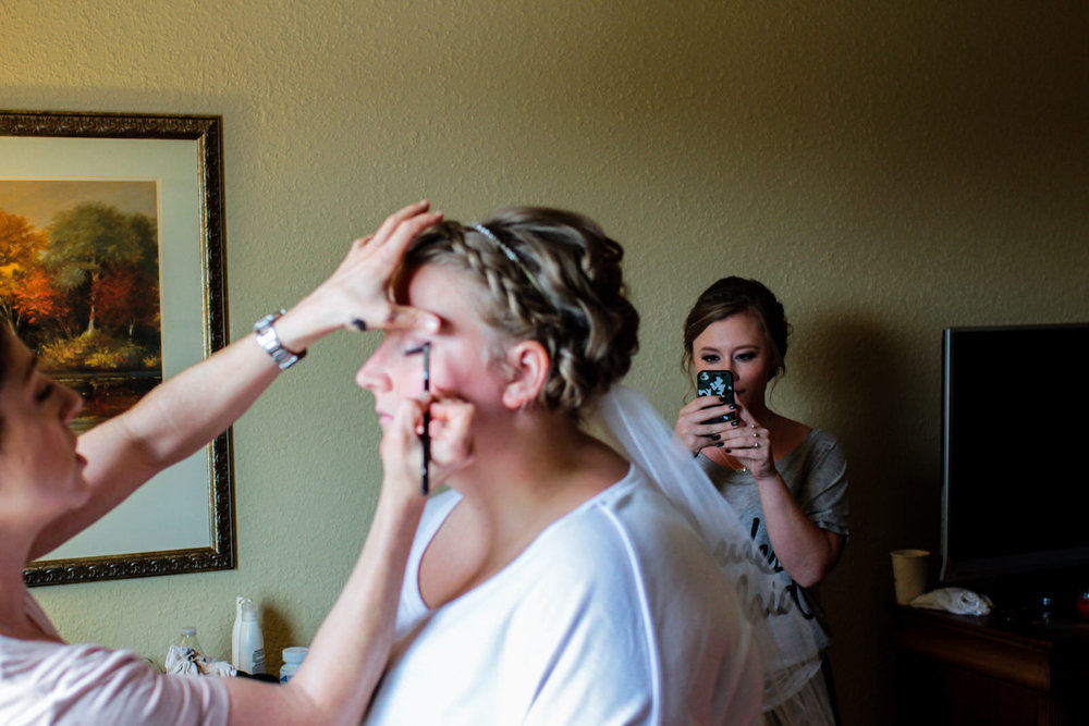 Valparaiso Bride, Kelsey, gets her makeup done before her summer wedding at The Red BArn Experience.