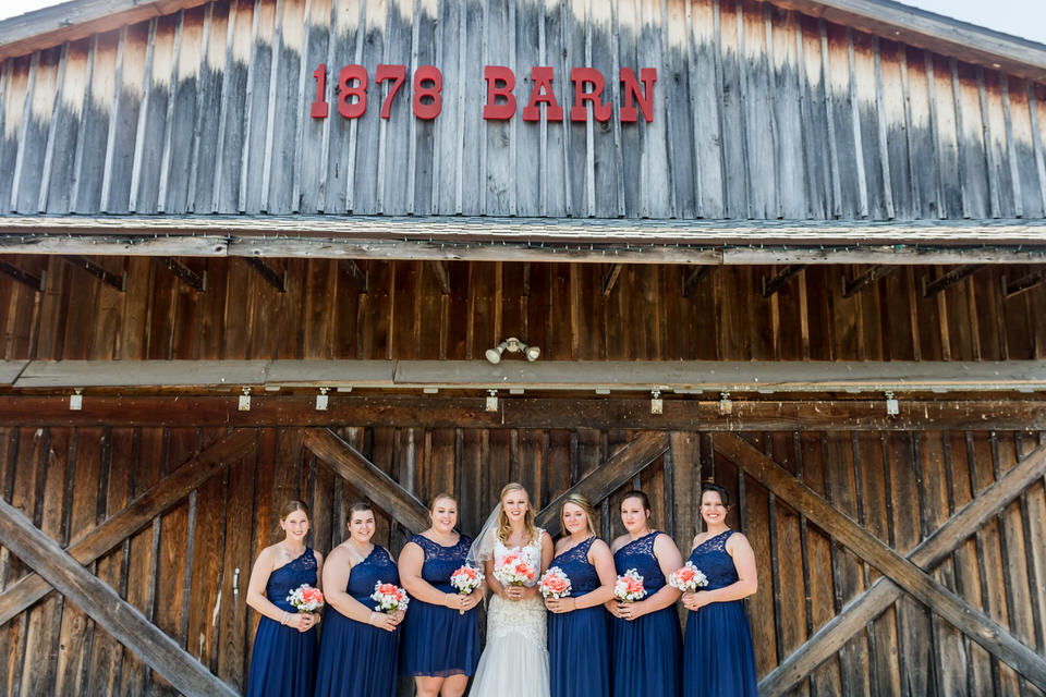The bridesmaids pose for a photo outside of brighton barn