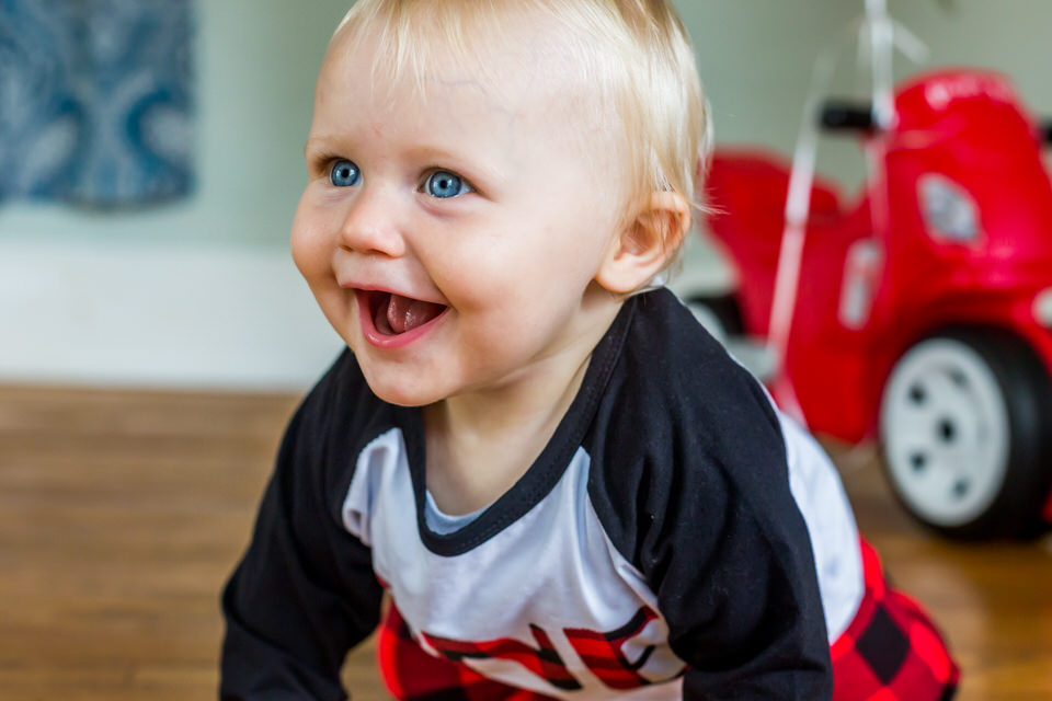 Cole laughs during his one year photos in the Anderson, Indiana photography studio