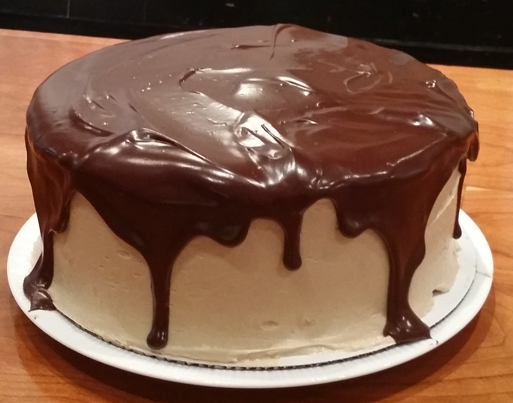 Chocolate cake with vanilla buttercream and a chocolate ganache topping