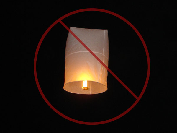 Flying lanterns work like hot air balloons.  The problem is, they can keep burning after drifting long distances and landing in the bush.