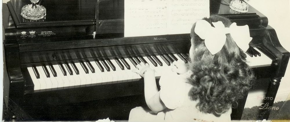 Located in Seattle, the Piano Studio of Katie O'Rourke encourages a home practice routine, as seen in this vintage photo!